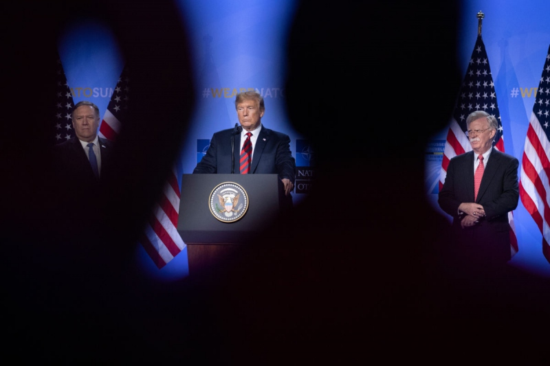 President Trump listens in between U.S. Secretary of State Mike Pompeo and National Security Adviser John Bolton during a news conference at the 2018 NATO Summit on July 12, 2018, in Brussels, Belgium. (Jasper Juinen / Getty Images)
